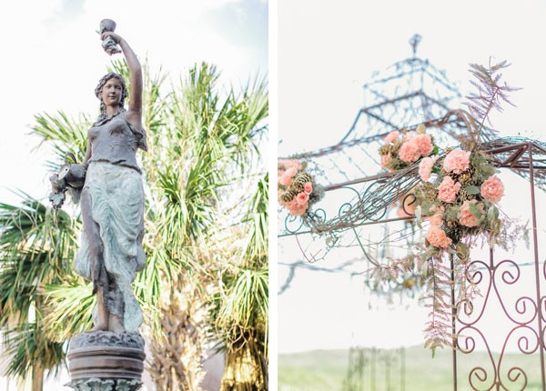 statue in garden and flower covered archway at summer garden wedding