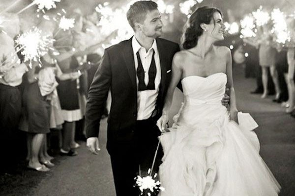 bride and groom exit to row of guests with sparklers