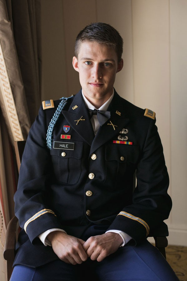 groom in dress uniform sitting in hotel