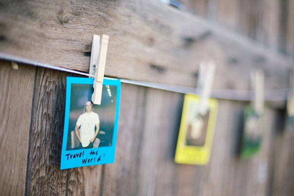 polaroids with NYE resolutions written on them hanging from decorative clothesline