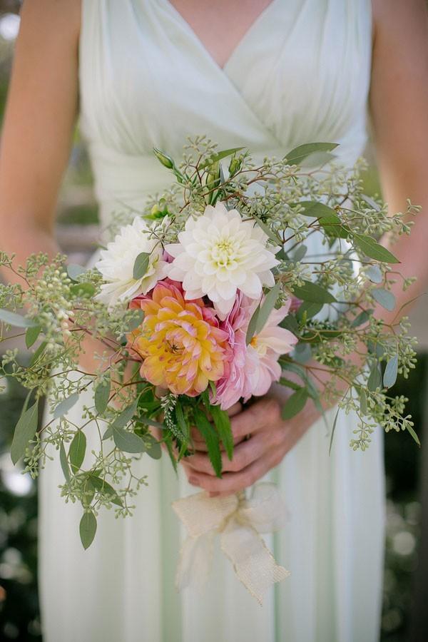 mint bridesmaid dress with dahlia bouquet