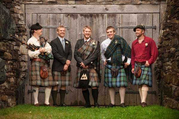 groom and groomsmen in kilts at farm wedding