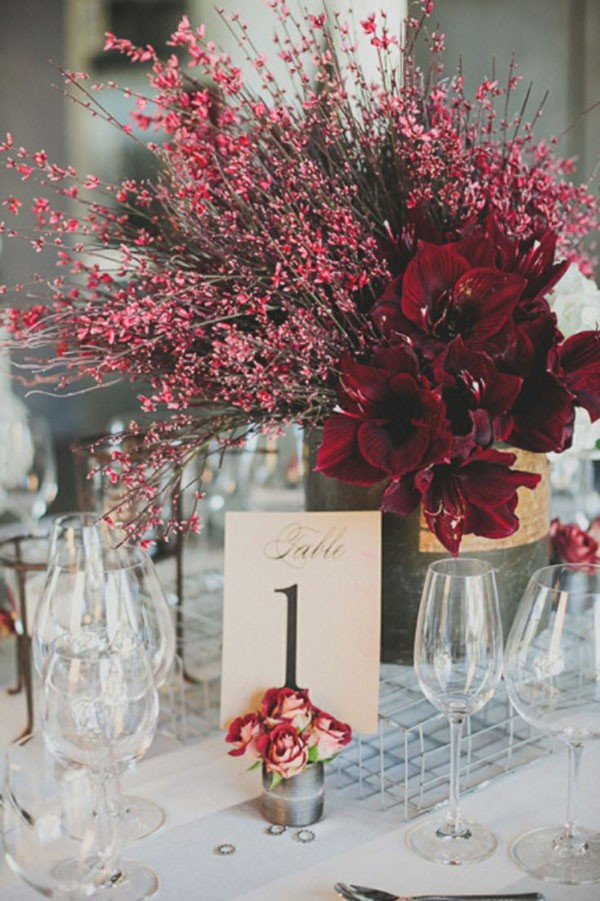red branch centerpiece for wedding with table number