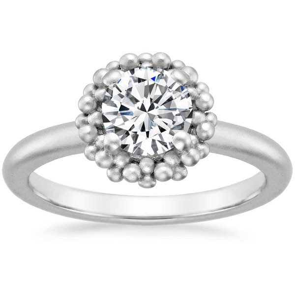 round diamond ring with setting of beads
