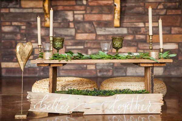 rustic sweethearts' table with candles and green goblets