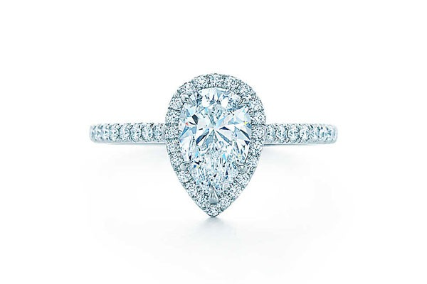 platinum engagement ring with pear cut center stone