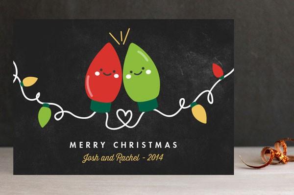 Christmas card with a pair of colored Christmas light bulbs