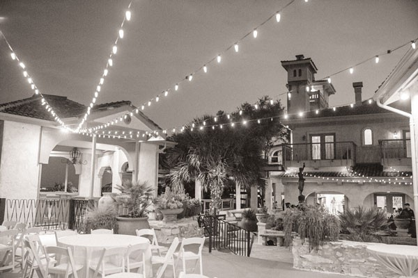 venue patio underneath rows of string lights during summer