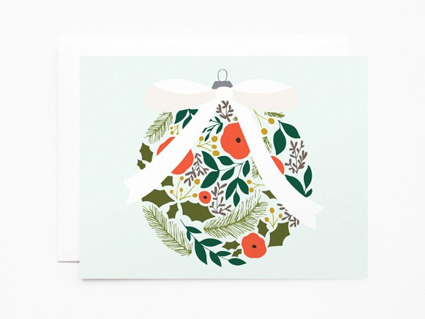Christmas card featuring ball ornament with floral illustration