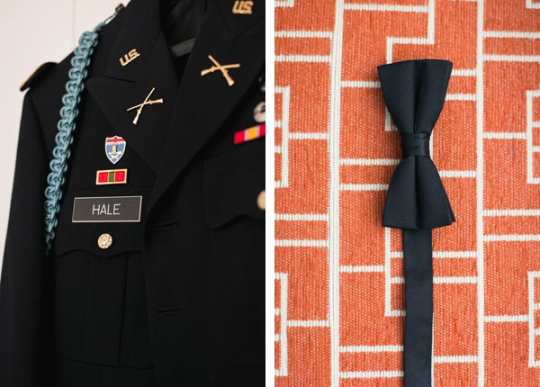 military uniform and bow tie hanging in hotel room