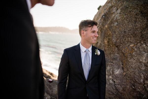groom waits for bride at coastal elopement