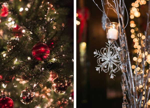 snowflake ornaments on centerpieces and red ornaments hanging from tree
