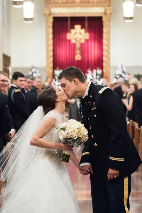 bride and groom kiss at end of aisle after ceremony