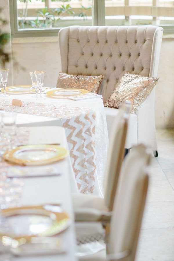 white and gold reception decor with sequined linens and pillows