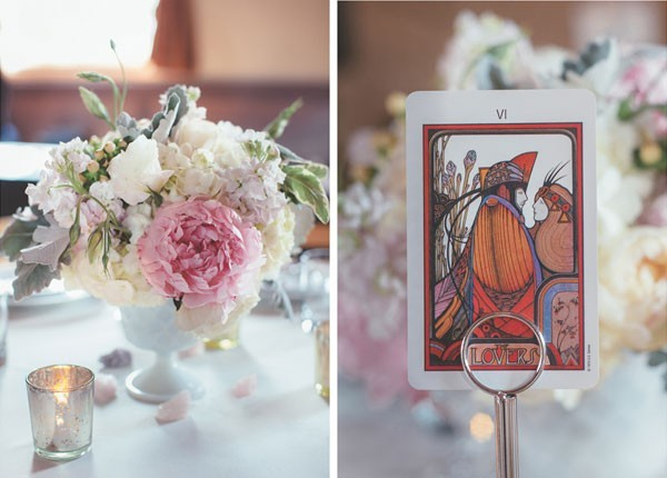 tarot card table numbers with soft floral centerpieces