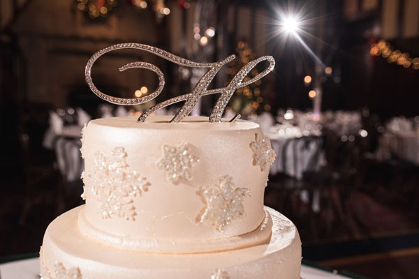 snowflake wedding cake with crystal monogram topper