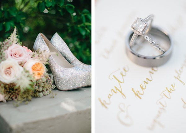 silver glitter platform pumps and wedding rings on top of invitation
