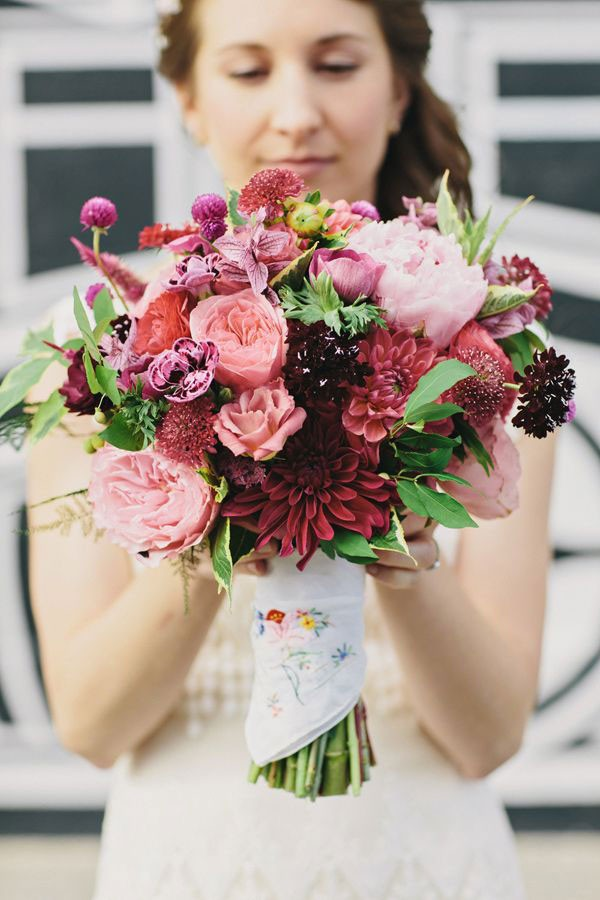 bridal bouquet with dahlias and peonies in pinks and reds