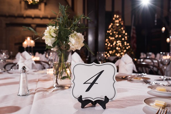 black and white table number in easel at Christmas reception