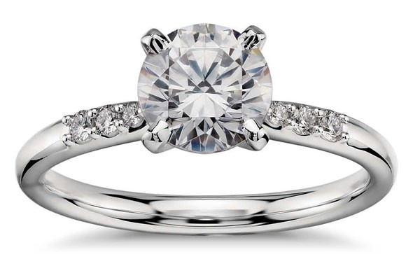 engagement ring with round diamond center stone