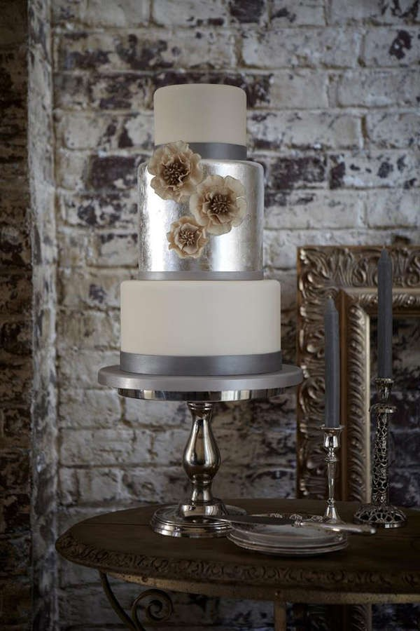 silver and white wedding cake with floral decor