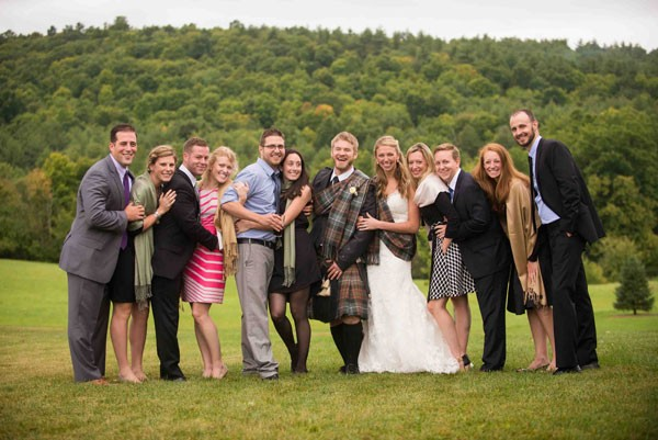 group of family and friends with bride and groom at Scottish themed wedding