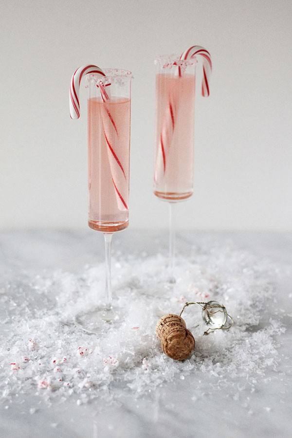 champagne cocktails with candy cane garnish