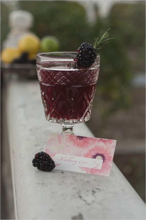 blackberry flavored beverage in glass goblet with garnish
