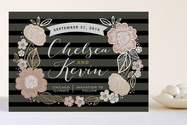 metallic highlighted floral pattern over black stripes on wedding invitation