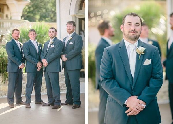 groom and groomsmen in charcoal gray suits and white pocket squares