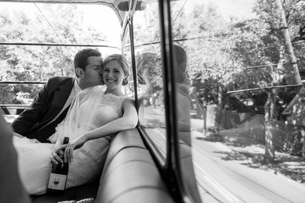 bride and groom relax on double decker bus