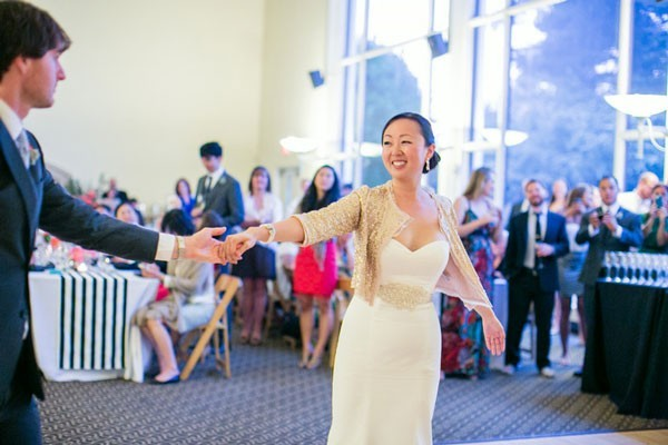 bride with gold sequined shrug over wedding dress