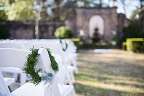 tiny greenery wreaths as aisle decor
