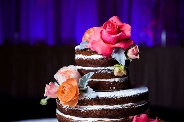 chocolate naked wedding cake with bright flowers