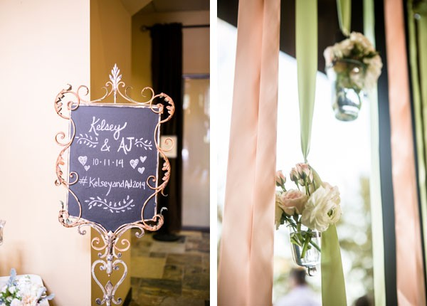 chalkboard welcome sign and streamers with flowers hanging over windows