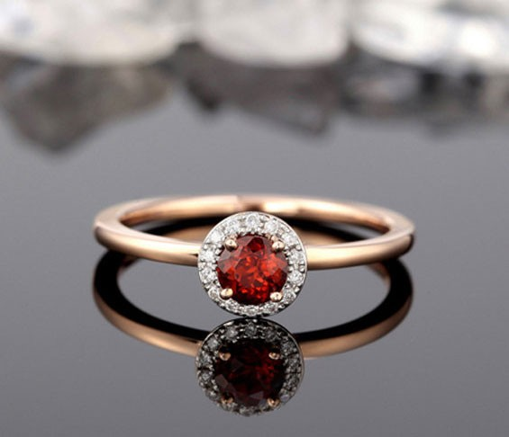 diamond and garnet engagement ring with small center stone