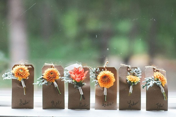 boutonnieres attached to Kraft paper against window