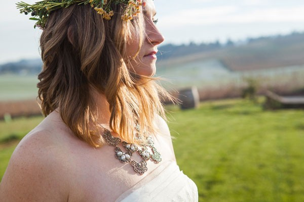 boho bride with bib necklace and flower crown