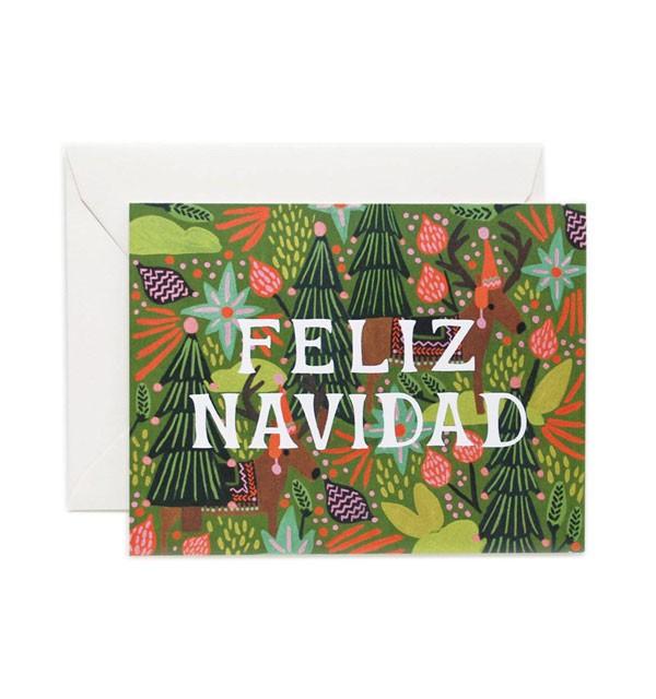 feliz navidad card with bright, Christmas tree background