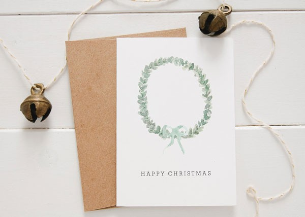 Christmas card with elegant, hand drawn, green wreath