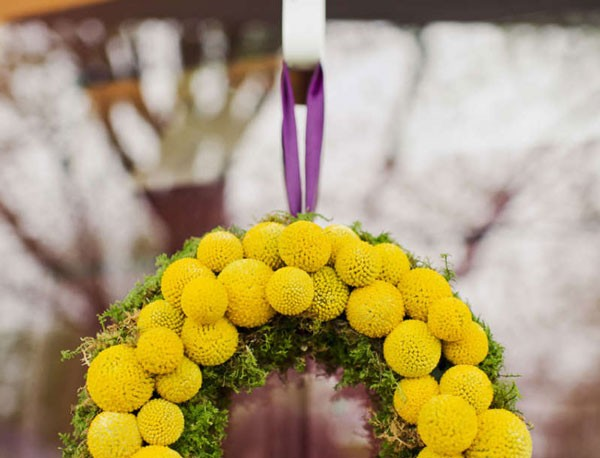 bright billy ball wreath with purple ribbon