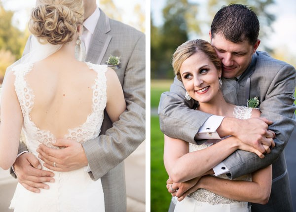 groom holding bride with low back wedding dress