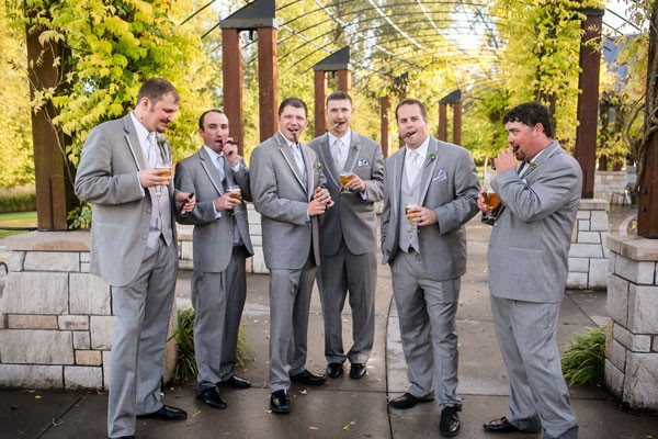 groom and groomsmen smoking cigars and drinking