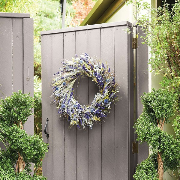 spring wedding lavender wreath hanging from garden gate