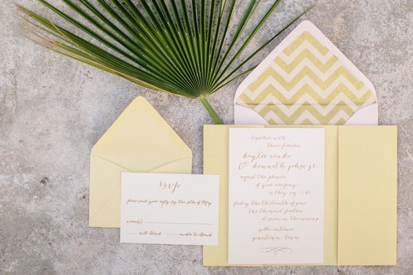 gold and white wedding invitation suite with chevron lined envelope