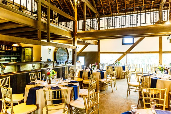 rustic wedding reception venue with high wooden beams