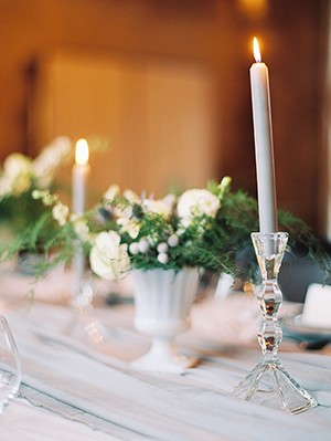 Milk glass vases and table arrangements by Hello Darlington from mywedding magazine photo by Kate Ignatowski