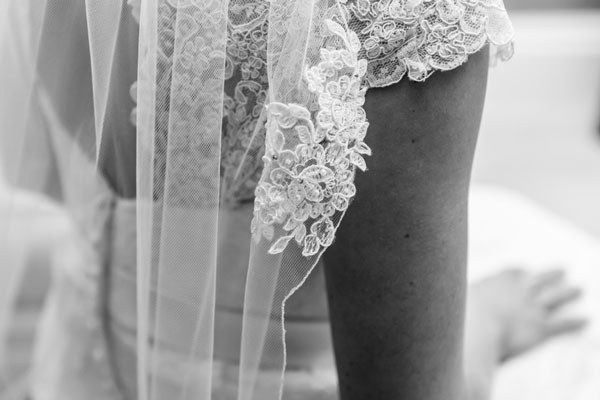 intricate lace detailing as trim of traditional veil