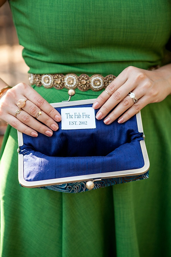 Blue clutch with embroidered note for a bridesmaid gift