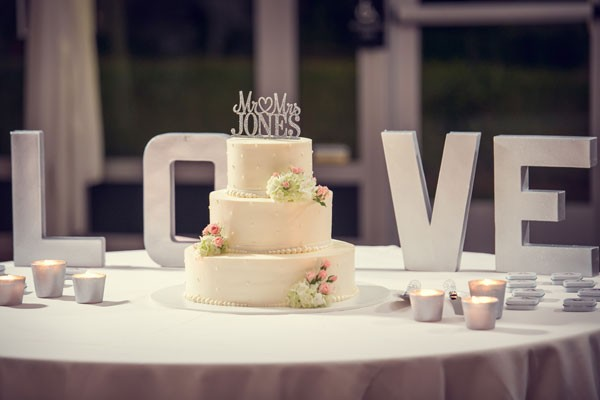 wedding cake with large love sign